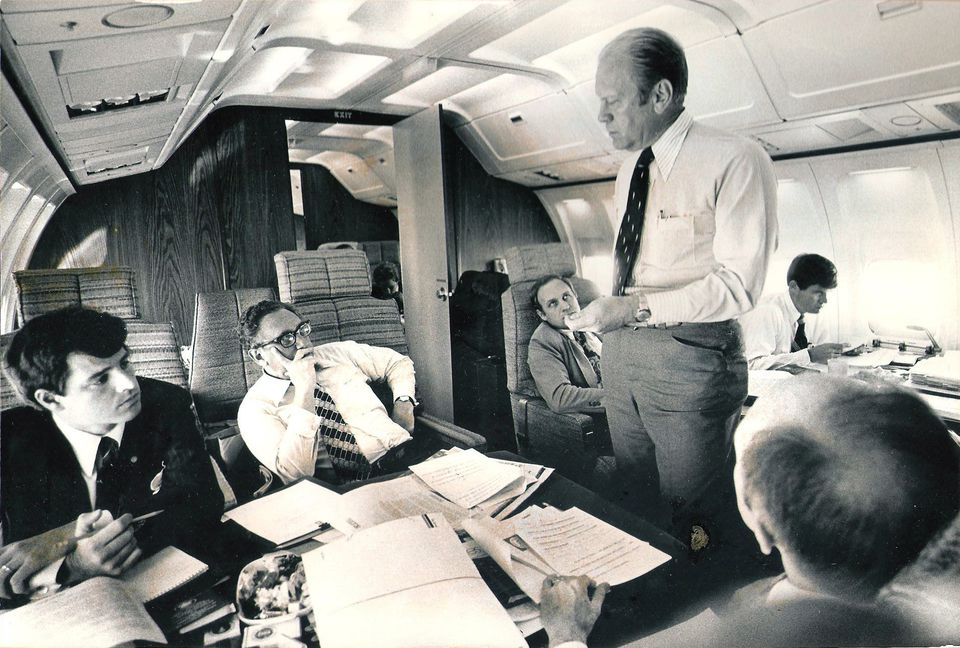 Paul Bremer (far left) rode to power in the post-Watergate era as Henry Kissinger's chief aide. His boss confers with President Ford aboard Air Force One in 1975; at Ford's right is chief of staff Dick Cheney.