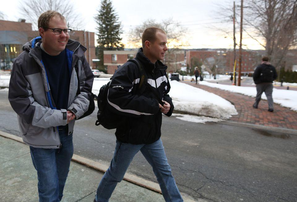 Johan Rijk (left) and his brother, Matt, left class at Framingham State University.