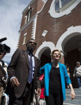 Pastor Leodis Strong walked withSenator Elizabeth Warren outside the Brown Chapel AME Church in Selma on March 19.