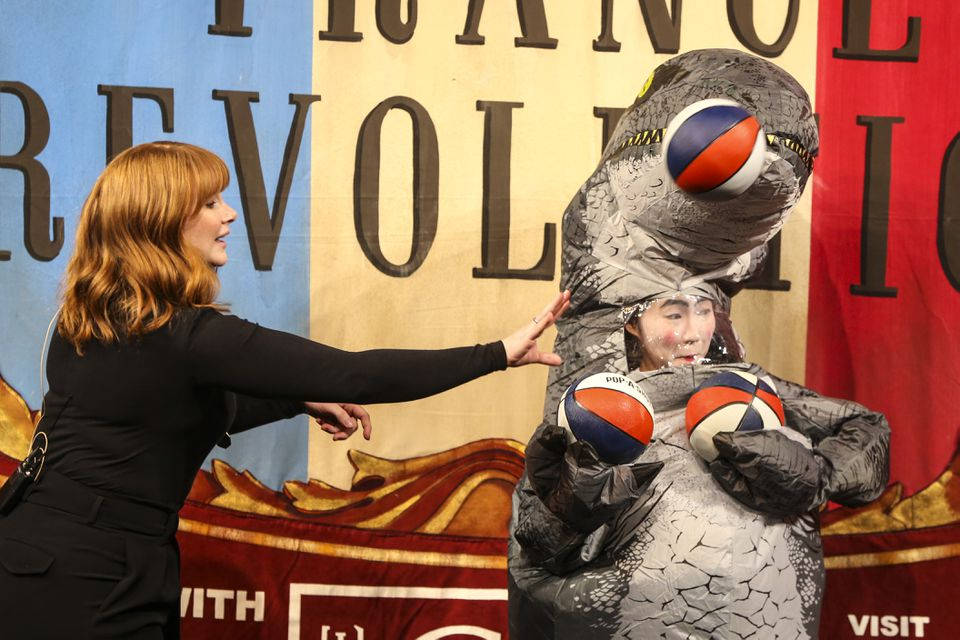 Bryce Dallas Howard (left) competes against Shirley Chen in a basketball shooting contest during the 69th annual Hasty Pudding Theatricals Woman of the Year Roast in Cambridge on Thursday afternoon.