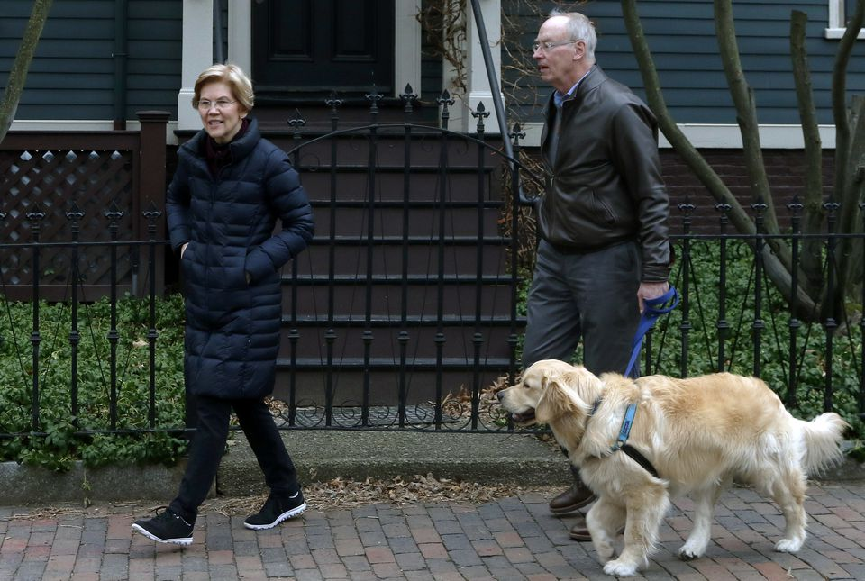 Senator Elizabeth Warren, a Massachusetts Democrat, stepped outside her Cambridge home with her husband Bruce Mann and their retriever Bailey on Monday.