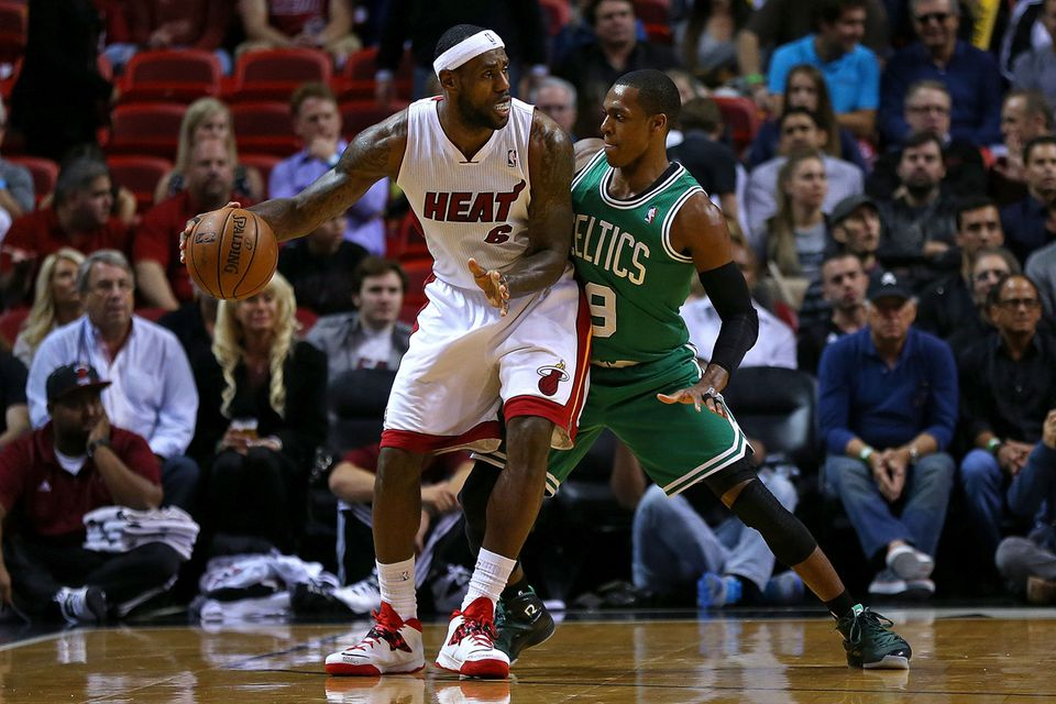 What Rajon Rondo gives up in height he appears to make up for in tenacity as he guards the Heat's LeBron James in the first half.