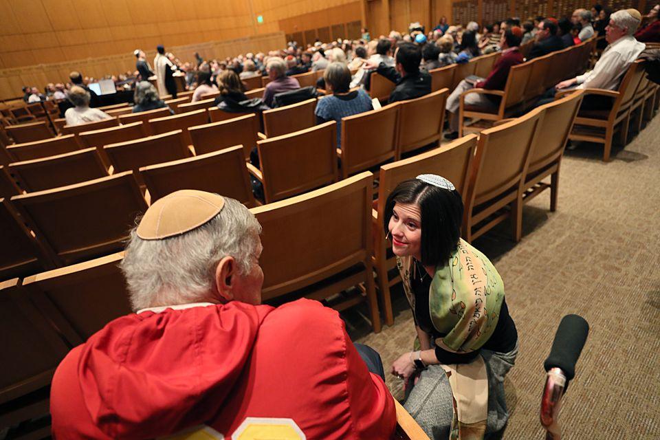Rabbi Rachel Saphire greeted a temple member during Shabbat service at Temple Beth Elohim.