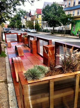 The city is considering adding lights to its stylized parklets to make them more inviting.