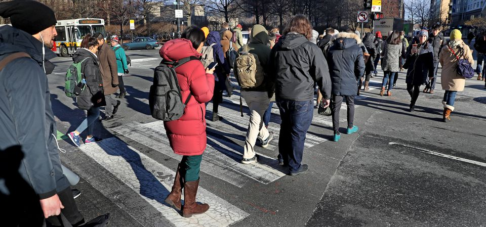 Pedestrians crossed Broadway in Cambridge, where the city is trying to reduce reliance on cars, with mixed results.