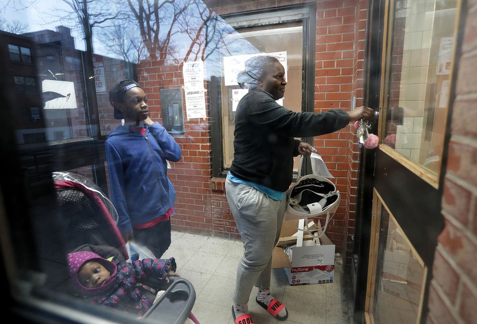 """Kyiesha Menzie and her son, Jordan Cage, at the Mildred C. Hailey Apartments in Jamaica Plain, a housing development being targeted for renewal. """"They should, one at a time, wipe them all out and start over,"""" Menzie said of the redevelopment plan."""