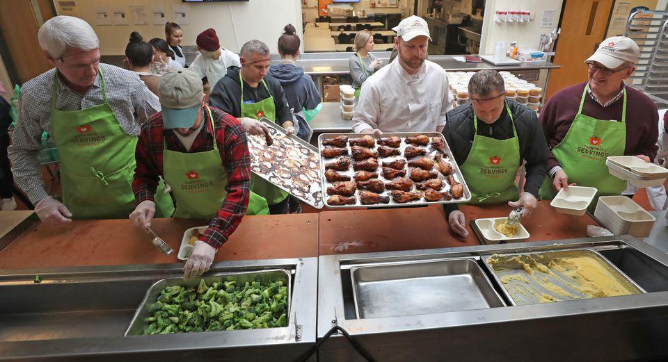 From left: Garrett Harker, Louis DiBiccari, David Bazirgan, Brian Hillmer, Andy Husbands, and David Waters prep food at  Community Servings.
