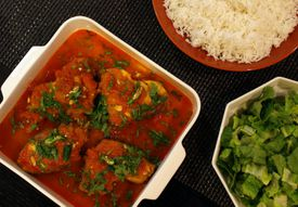 Rokeya and Solmon Chowdhury's poached fish in spiced tomato gravy.
