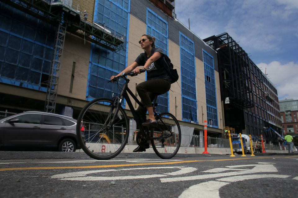A cyclist on the new protected bike lane on Causeway Street.