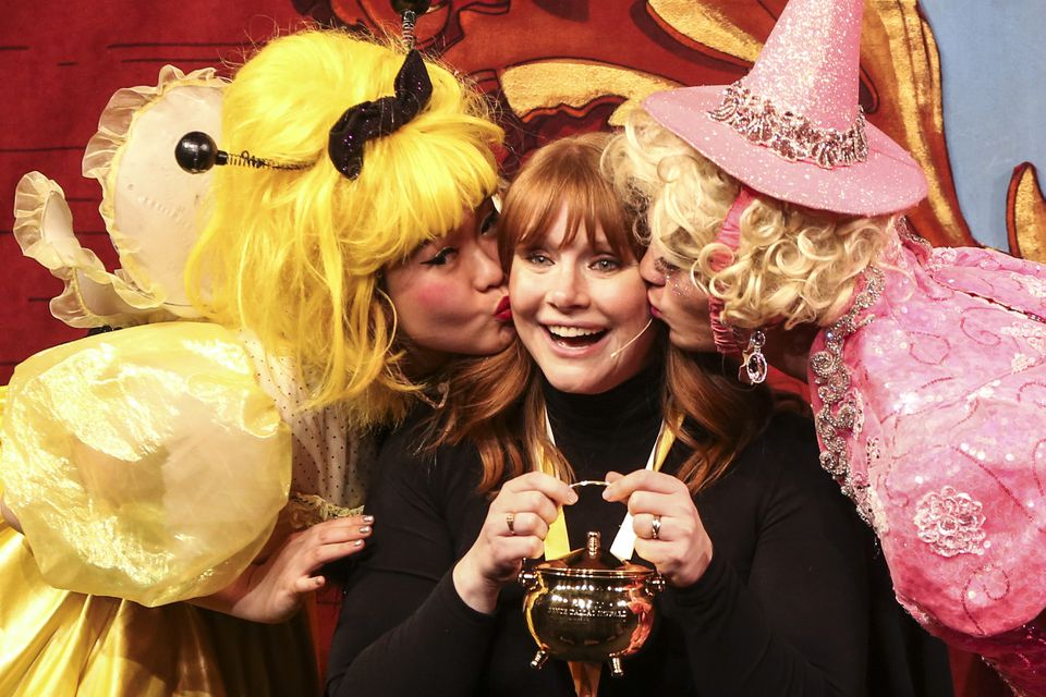 Bryce Dallas Howard (center) receives kisses on both cheeks after being presented with the Pudding Pot during the 69th annual Hasty Pudding Theatricals Woman of the Year Roast in Cambridge on Thursday afternoon.