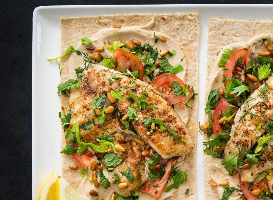 Lebanese-style fish (samkeh harra) sandwich with tarator.