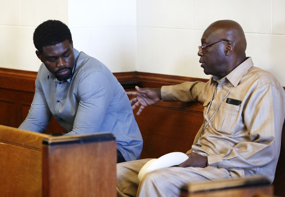 Kyle Pam (left) spoke with his father, Rolando Pam, before his arraignment Thursday.