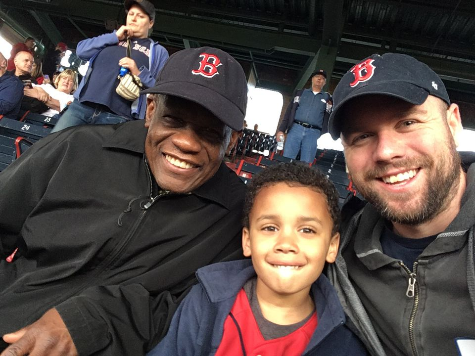 From right, Calvin Hennick, his 6-year-old son, Nile, and Hennick's father in law, Guy Mont-Louis. They attended Tuesday night's game at Fenway Park.