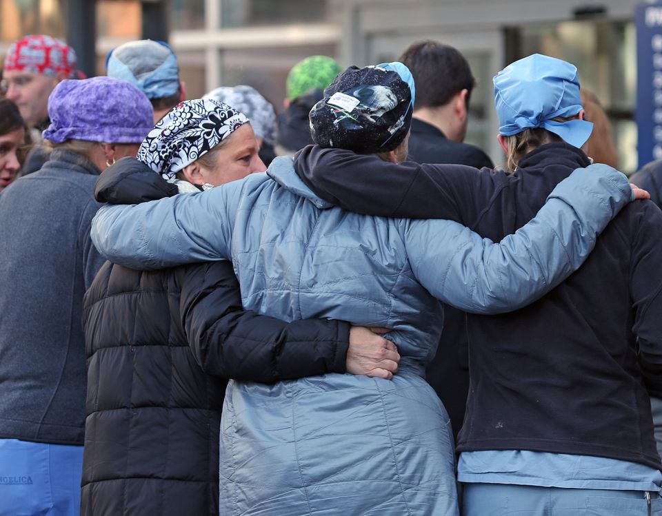 Brigham and Women's staff members held each other after a memorial service for Dr. Michael Davidson.
