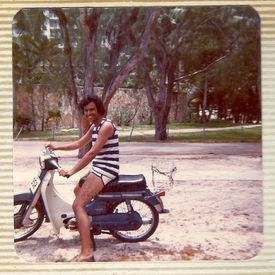 A family photos shows Leonard as a young man on a moped.