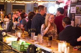 Patrons await the start of a performance Tuesday night by Rickie Lee Jones, the last national act to play at Johnny D's.