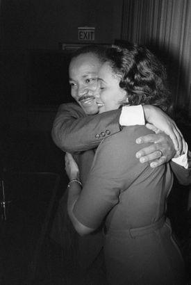 Martin Luther King Jr. hugs his wife, Coretta, during a news conference following the announcement that he had been awarded the Nobel Peace Prize.