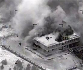 A structure in Tall Al Qitar, Syria, is seen moments after a US strike on Tuesday in one of more than 200 air strikes against militant targets.