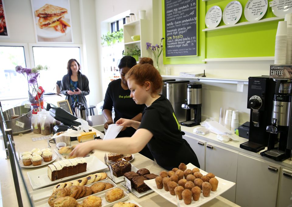 Leah Hainline prepares a selection for a patron at The Plate in Milton, where all sandwiches, soups, and bakery items are made from scratch.