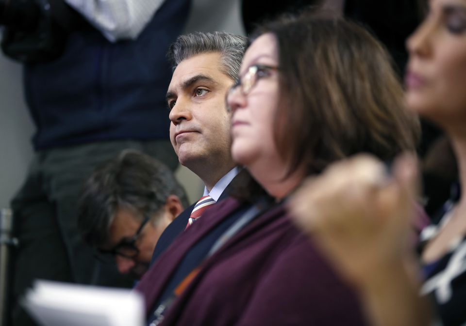 CNN's Jim Acosta, left, at the press briefing.