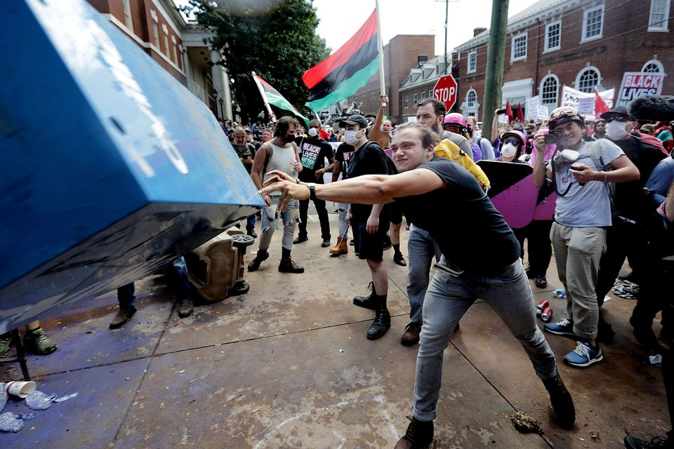 A counterprotester threw a newspaper box toward white nationalists in Charlottesville on Saturday.