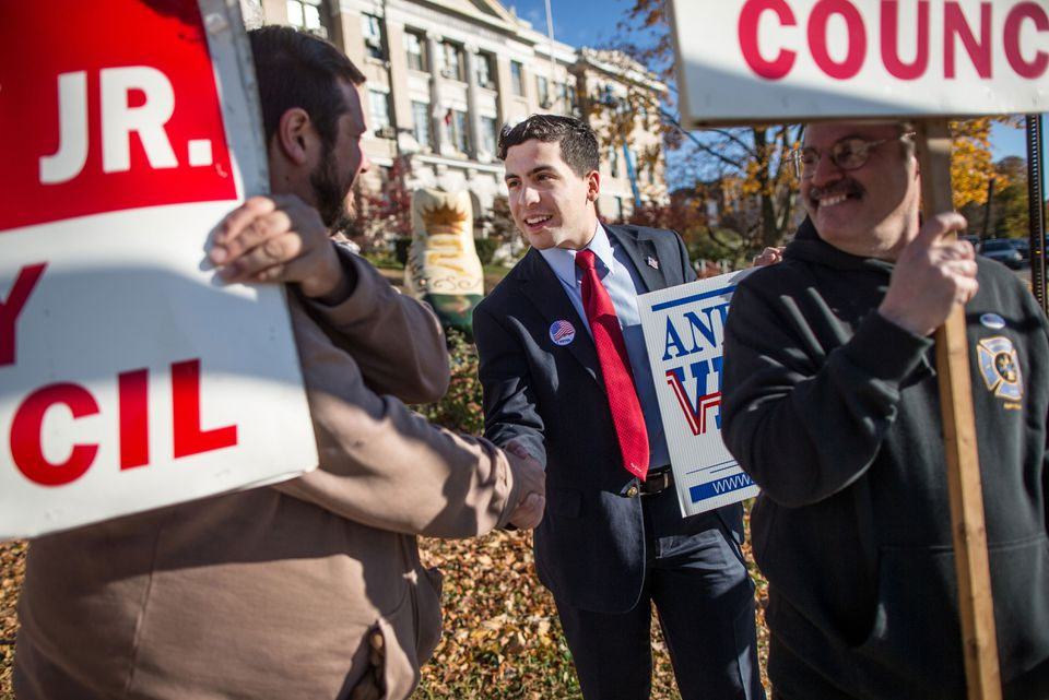 Andy Vargas (center) campaigned outside the Haverhill Public Library on Election Day. Vargas, 22, was elected to a council-at-large seat.