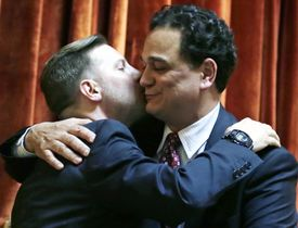 Rhode Island House Speaker Gordon Fox (right) embraced his partner, Marcus LaFond, after the vote.