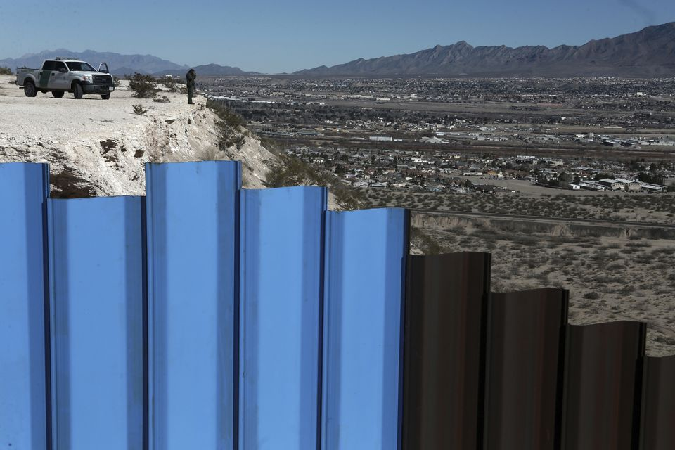 An agent of the border patrol, observed near the Mexico-US border fence, on the Mexican side, separating the towns of Anapra, Mexico and Sunland Park, New Mexico, this week.