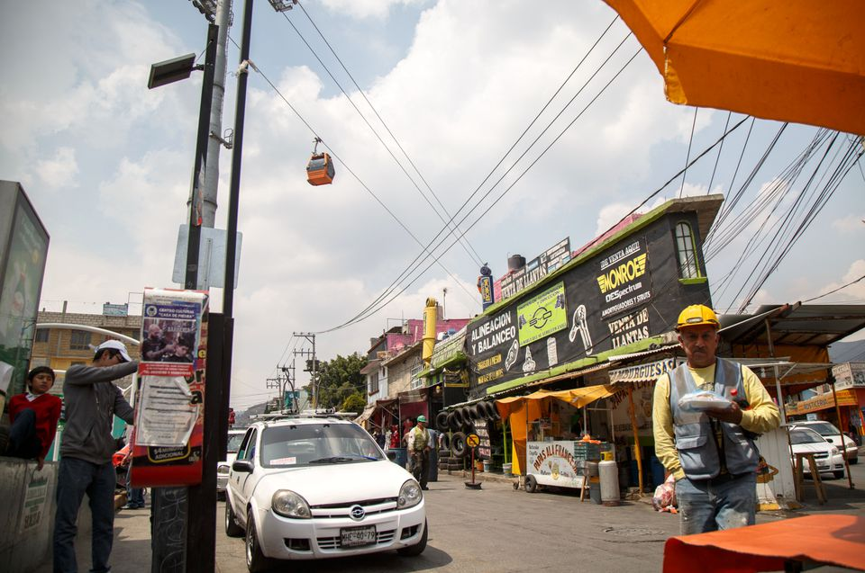 Gondolas flew overhead in Ecatepec de Morelos, Mexico, as part of an aerial tramway that opened in 2016 to ease the commute to crowded Mexico City.