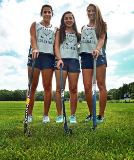 From left: Shrewsbury High field hockey captains Peyton Tuccinard, Alexandra Johnson and Jackie Loiseau pose together on the school's natural grass playing field.