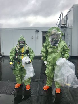 Members of the hazmat team investigated on the roof of the hotel.