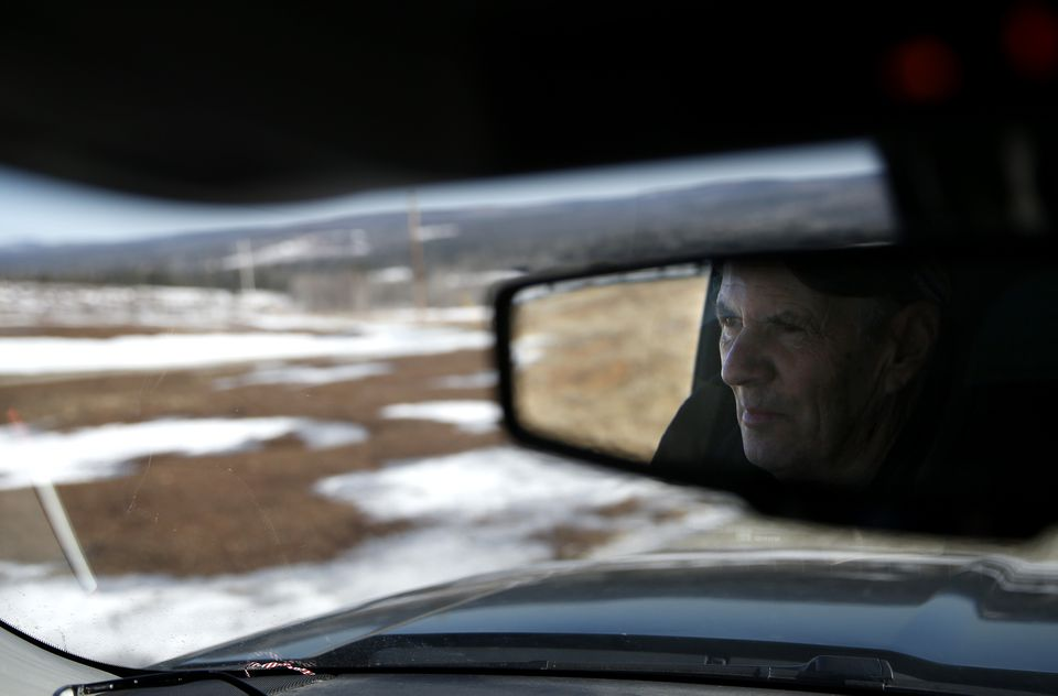 Jordan was reflected in the rearview mirror of his truck as he drove up the hill where he grows blueberries.