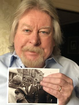 Alex MacDonald holding a photograph of his encounter with Robert F. Kennedy at the St. Patrick's Day Parade in South Boston in 1968.