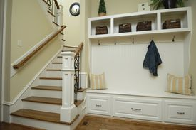 <b>MAKING THE MOST:</b> Adding a built-in bench and shelving can maximize unused hallway space.