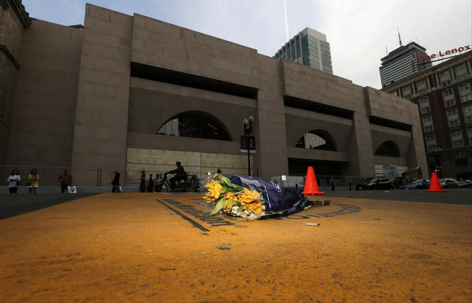 A bouquet of flowers were put on the Marathon finish line after Friday's sentencing.