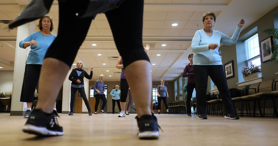 """Instructor Cassandra Hunt, foreground, leads a """"Zumba Gold"""" class at  the Sharon Adult Center."""