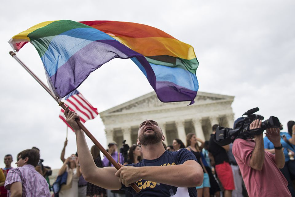 Vin Testa waved a rainbow flag outside of the Supreme Court after Friday's decision in support of marriage equality.