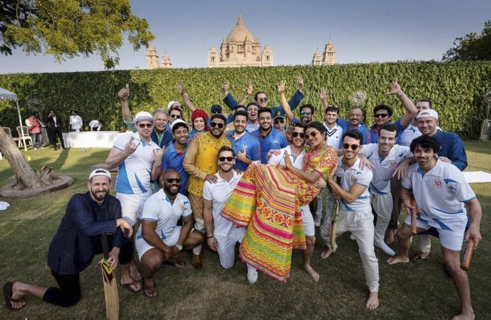 The couple posted for a photograph with others after a cricket match on Friday.