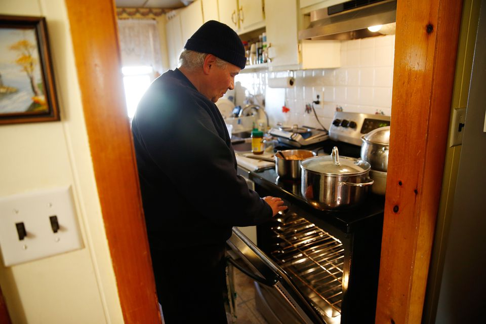 Thomas Baca, 60, and his wife have been using their electric oven to warm their apartment in South Lawrence. With colder weather approaching they've finally broken down and called about getting a hotel and are waiting to hear back from Columbia Gas for arrangements.