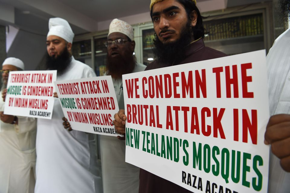 Indian Muslims and clerics held posters to condemn the mass shooting.