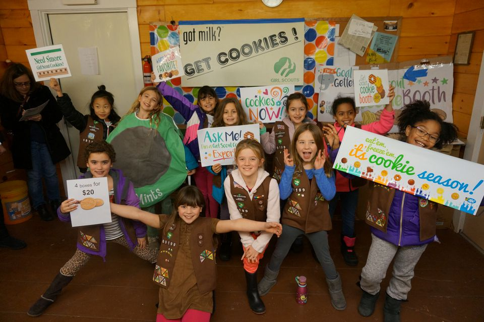 These girls from Wayland are among the many Scout troops selling cookies this time of year.