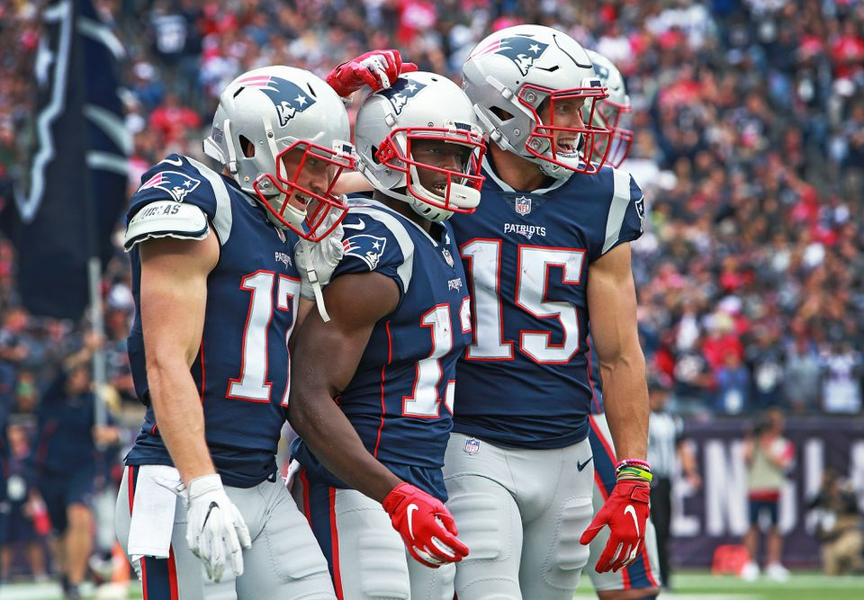 From left to right: Riley McCarron, Phillip Dorsett and Chris Hogan celebrated together Dorsett's touchdown reception at the end of the first half.