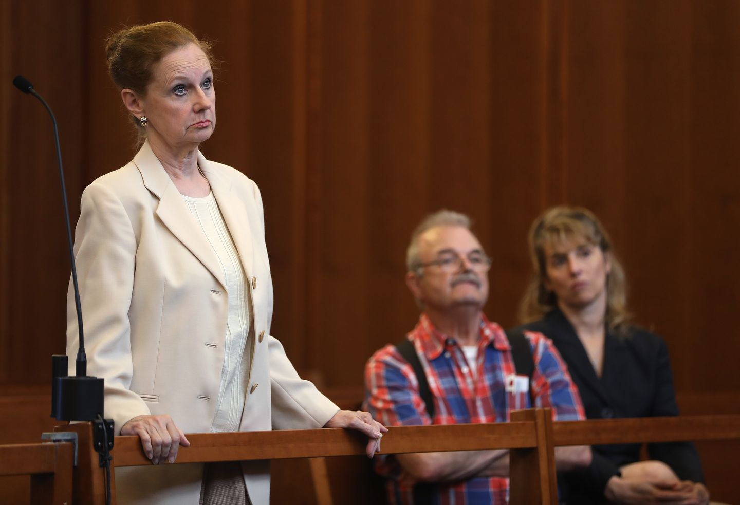 Barbara Bennett faces felony assault charges, accused of releasing two dogs of pit bull mix on her Marshfield neighbor.