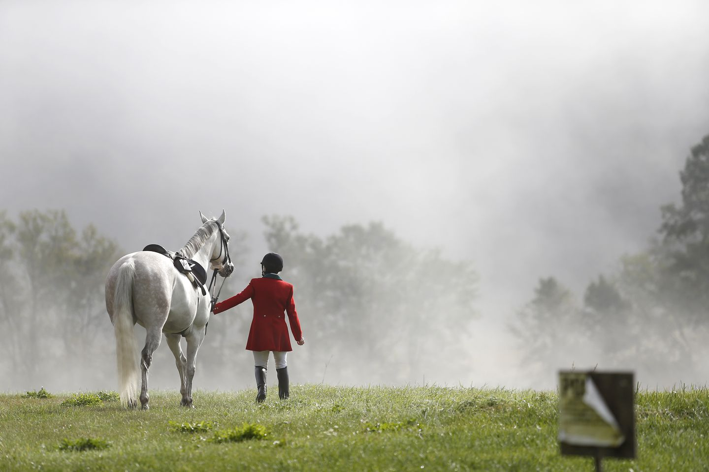Peggy Racine walks her horse, Stretch, over to the barn for the Blessing of the Hounds.