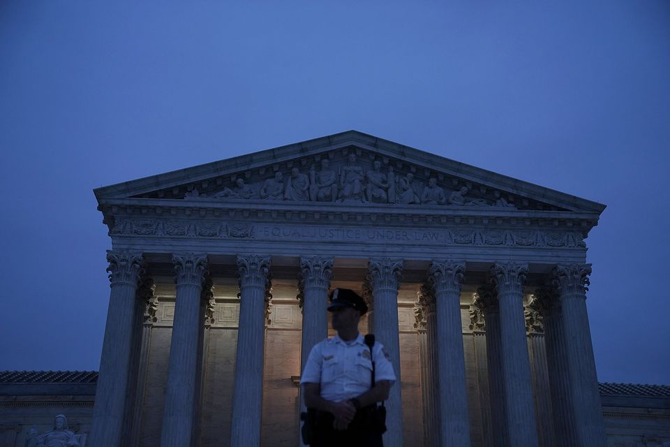 A police officer stands guard in front of the US Supreme Court building on Oct. 5.