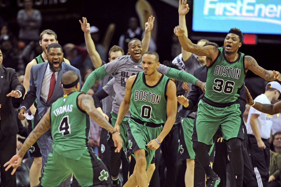 The jubilant Celtics celebrate after guard Avery Bradley (0) nailed the winning 3-pointer as time expired to beat the Cavaliers.