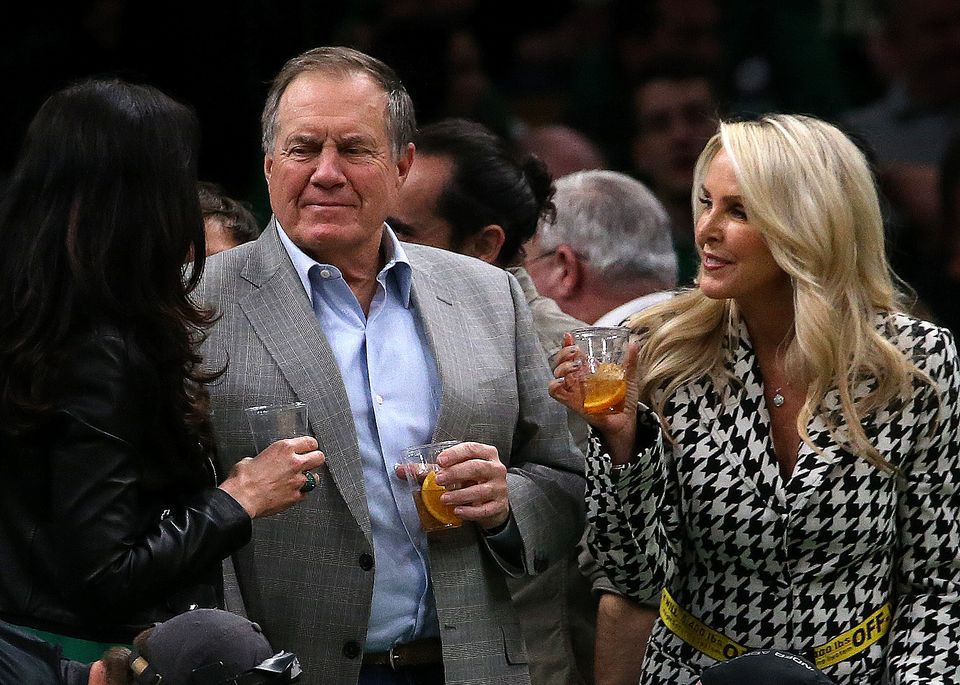 Patriots head coach Bill Belichick and his girlfriend Linda Holliday (right) attended Wednesday night's game at TD Garden.