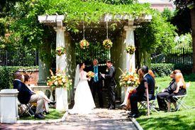 A 2010 wedding photo of Casey Brennan (left) and Major Shannon McLaughlin.