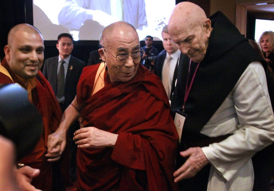 """The Rev. Thomas Keating (right) with Tibetan exiled spiritual leader the Dalai Lama (center), at  """"Beyond Religion: Ethics, Values and Well-Being,"""" where both men spoke, at the Marriott Copley Place hotel, Oct. 14, 2012."""