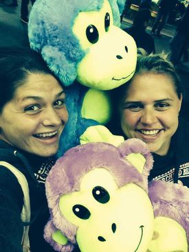 Tamara Bruce, left, and her sister Megen, after winning stuffed monkeys in a carnival game at Old Orchard Beach in 2013.